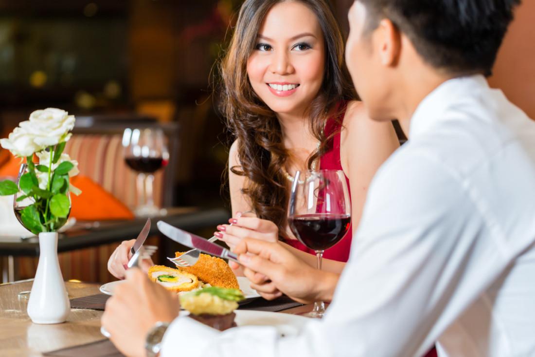 Chinese couple having romantic dinner in fancy restaurant