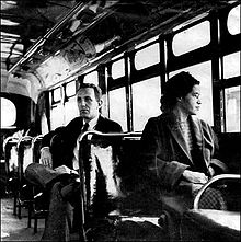 Rosa parks on a bus after the segregation law was lifted