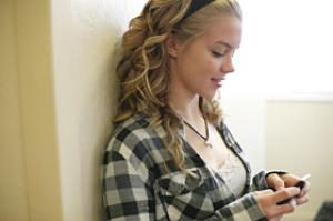 teen girl text messsaging at school