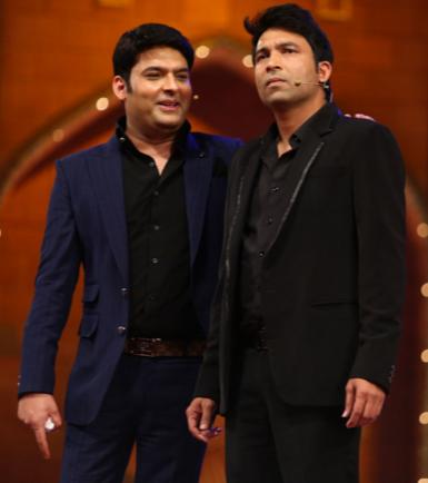 Kapil Sharma with one of the team members of the Kapil Sharma Show