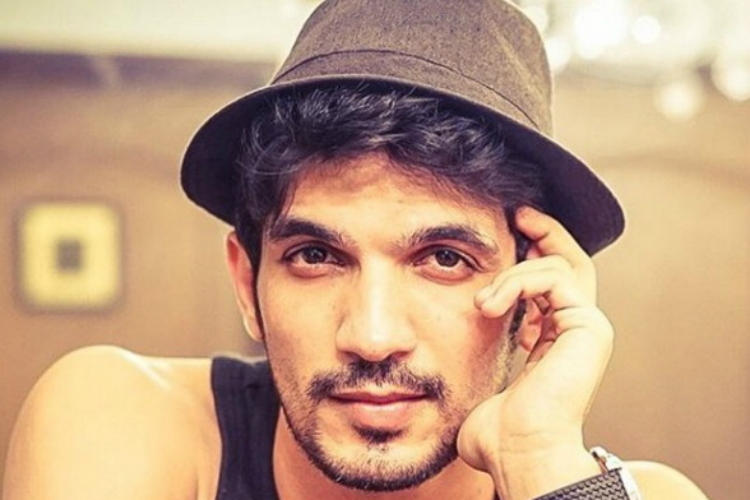 Arjun bijlani height weight age wife affairs more for Chintu khan