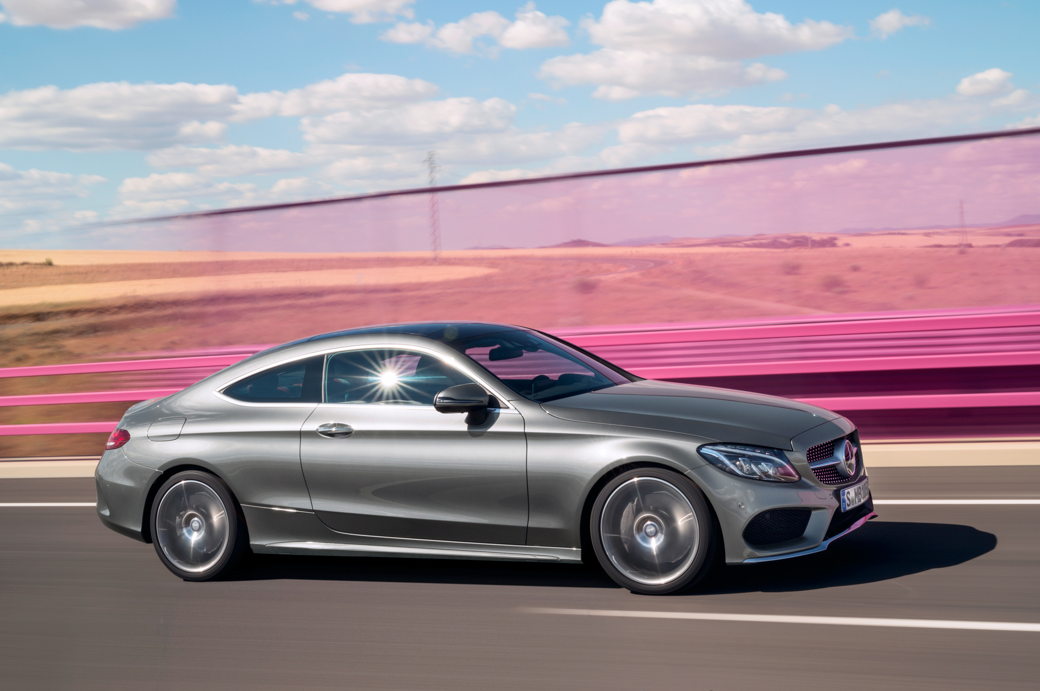 2017-Mercedes-Benz-C300-Coupe-side-in-motion-02